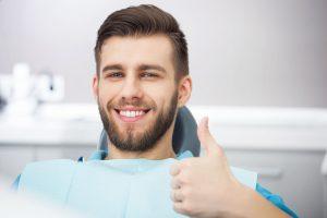 Young Man in Dentist Chair Getting Dental Health Checkup - Steven T. Cutbirth DDS Waco TX